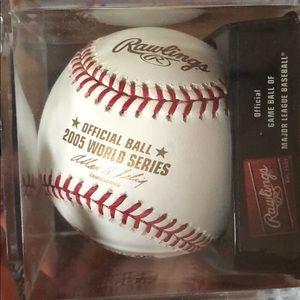 Two major league baseballs — never used